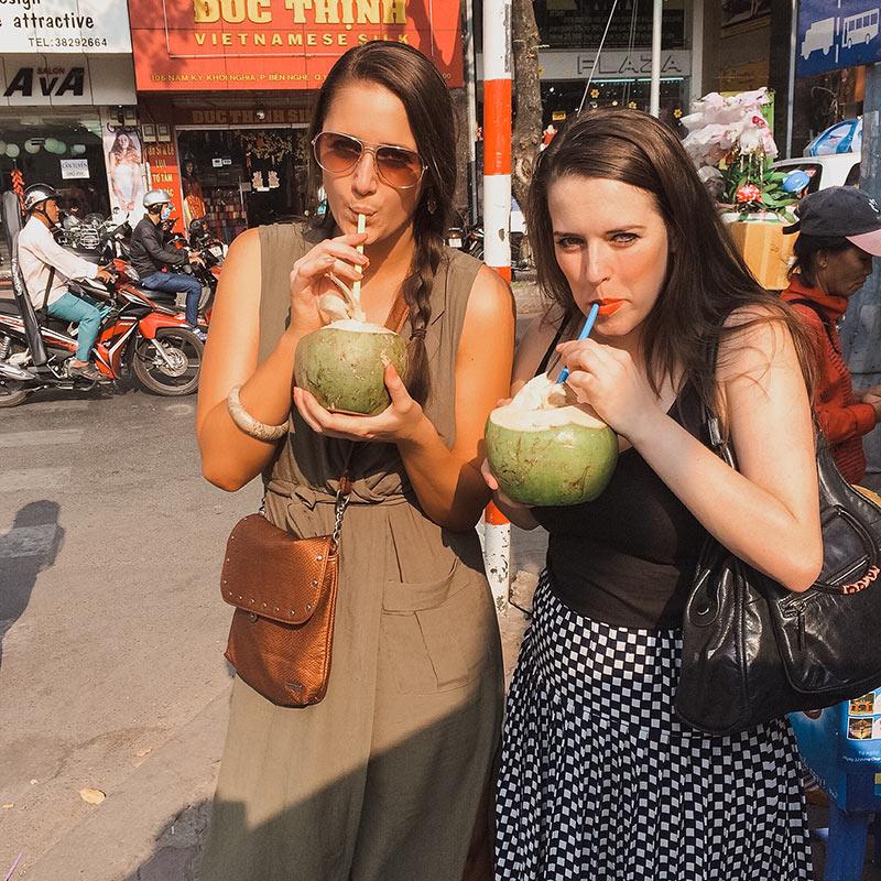 Saigon, Vietnam - Drinking coconuts on the street
